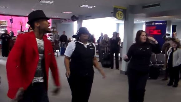"Delta Airlines employees break out into flash mob to ""Uptown Funk"" at Jackson airport."