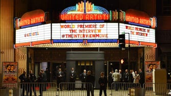"""Security is seen outside The Theatre at Ace Hotel before the premiere of the film """"The Interview""""  in Los Angeles on Dec.11,"""