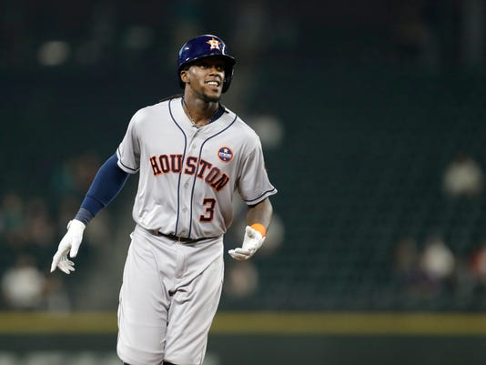 FILE - In this Sept. 6, 2017, file photo, then-Houston Astros' Cameron Maybin rounds the bases after hitting a two-run home run against the Seattle Mariners, during a baseball game in Seattle. Outfielder Cameron Maybin has signed a one-year contract with the Miami Marlins, rejoining the team where he played in 2008-10. Maybin gives the young, rebuilding Marlins much-needed experience, along with flexibility because he can play all three outfield positions. (AP Photo/John Froschauer, File)