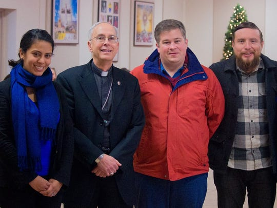 Blanca Navarrete, left to right, Bishop Mark J. Seitz, Dylan Corbett and Omar Rios.