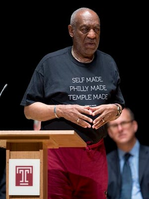 FILE - In this June 4, 2014, file photo, entertainer and former classmate Bill Cosby speaks during a public memorial service for Philadelphia Inquirer co-owner Lewis Katz at Temple University in Philadelphia. Cosby and Temple University have parted ways, but his lawyer is feeling heat for continuing to serve on the university's board of trustees. The head of the school's faculty union this week called for Patrick O'Connor to resign from the board, where he is the chairman. The administration of the Philadelphia university is strongly backing O'Connor.  (AP Photo/Matt Rourke, File)