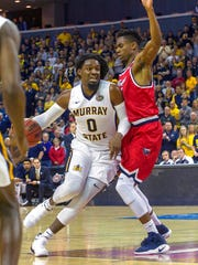 Murray State's Terrell Miller (0) drives the ball as