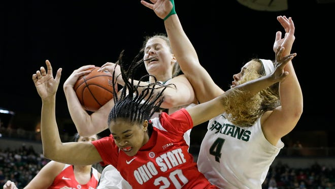 Michigan State center Jenna Allen, back left, grabs a rebound in front of center Jasmine Hines (4) and Ohio State guard Asia Doss (20) during the first half Saturday in East Lansing.