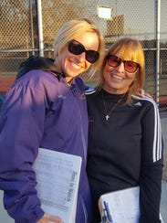 Westlake High tennis coach Connie Flanderka, right,