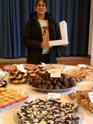 Julie Hering of Poughkeepsie selects her favorite treats