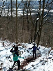 "Runners take on the danger-filled ""Shope Descent"" at"