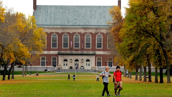 Students walk on the campus of UMaine-Orono in this file photo. The University of Maine System has adopted a set of principles to guide campuses in welcoming back students Aug. 31.