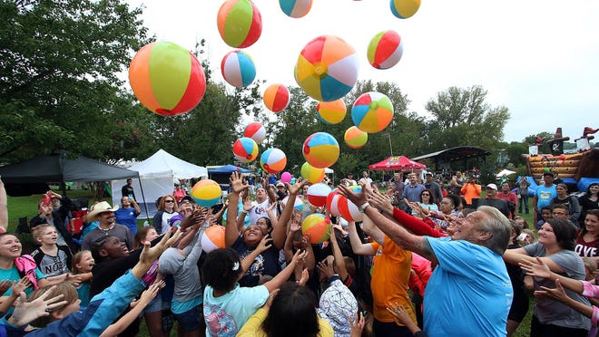 People gather to take part in the Beach Ball Drop  during the annual Kings Mountain BeachBlast at Patriot's Park in Kings Mountain.
