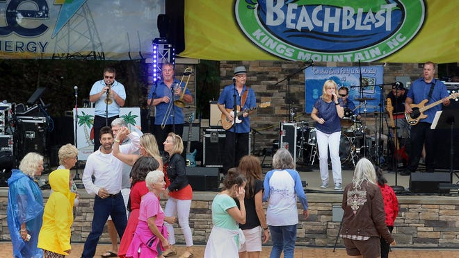 People dance to the music of the Party Prophets with Cindy Ford and Gene Pharr during the 2019 Kings Mountain BeachBlast.