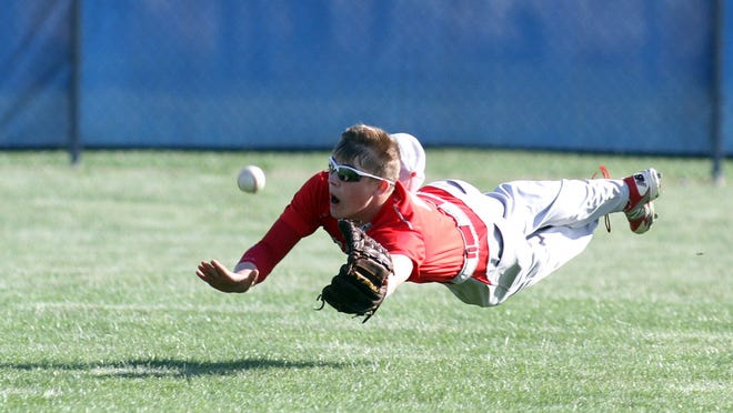 Elgin center fielder Noah Haynes dives for a shallow fly ball during a Comets game last spring.