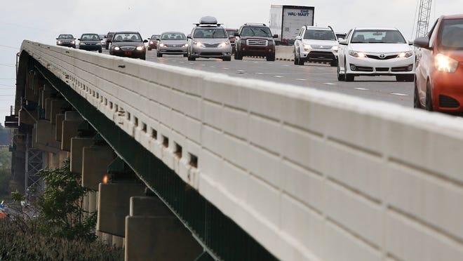 Traffic flows over the fully reopened span of the I-495 on Saturday.