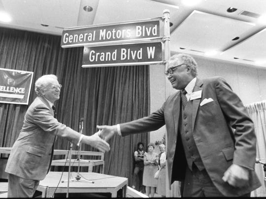 Detroit Mayor Coleman Young shakes hands with General Motors Chairman Roger Smith, left, in mid 1980's after Grand Blvd was renamed General Motors Blvd.