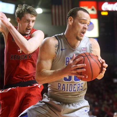 MTSU's Reggie Upshaw Jr. (30) turns to go up for a