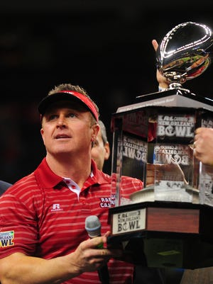 UL coach Mark Hudspeth, shown here hoisting the trophy following the Cajuns' 2012 New Orleans Bowl win, is okay with the NCAA's three-year moritorium on new bowls.