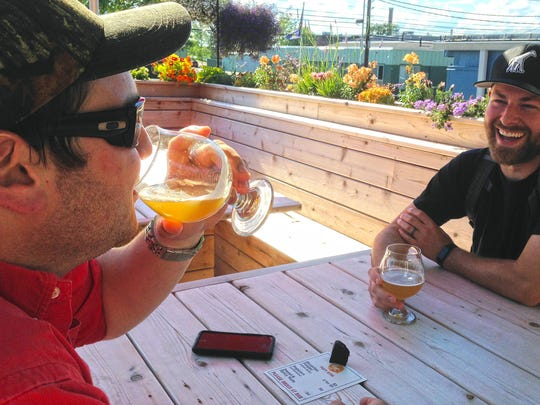 John Barone, left, and Steve Shepard, enjoy beers Monday