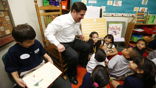 Arizona Gov. Doug Ducey talks with the 1st graders during a visit to Phoenix Collegiate Academy on Tuesday, Aug. 11, 2015 in Phoenix, AZ.