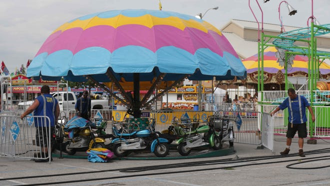 Midway workers set up for last year's Indiana State Fair. The 2016 Indiana State Fair runs Aug. 5-21.