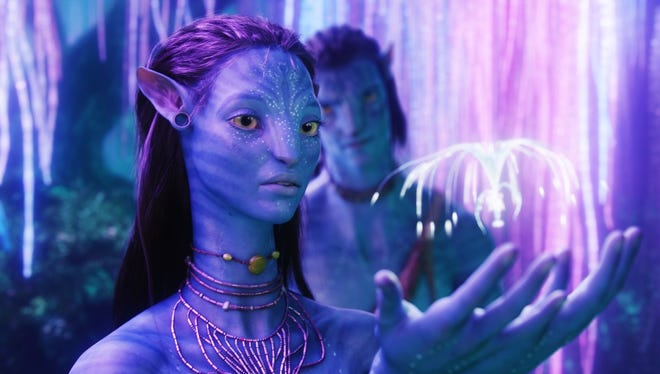 "Sam Worthington as Jake Sully and Zoe Saldana as Neytiri in a scene from James Cameron's ""Avatar."""