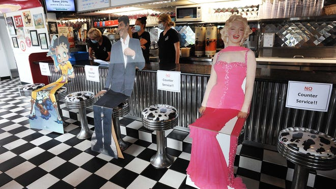 Celebrity cutouts  where there is no counter service at  Dave's Diner, 390 West Grove Street, Middleboro , on Tuesday, June 23, 2020, reopened for indoor dining.   Marc Vasconcellos/The Enterprise)