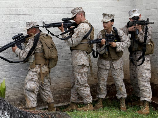 In this April 2013 file photo, Marines stack and prepare