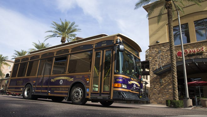 The Scottsdale Trolley drives its route through the Waterfront area of Scottsdale on July 10, 2017.