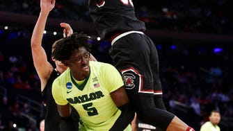 Baylor forward Johnathan Motley (5) is double teamed by South Carolina forward Chris Silva (30), a 2015 Roselle Catholic graduate, and forward Maik Kotsar in the first half of an East Regional semifinal game of the NCAA men's college basketball tournament, Friday, March 24, 2017, in New York. (AP Photo/Frank Franklin II)