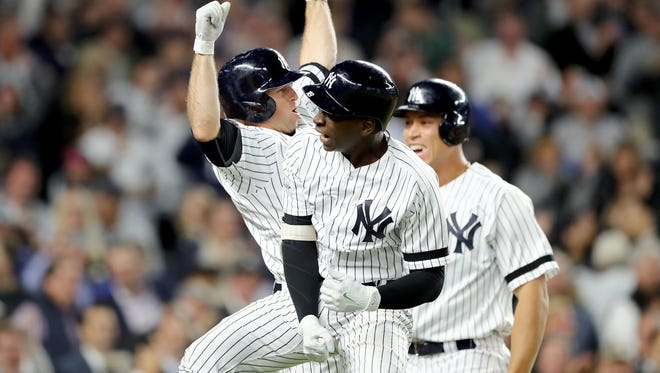 Didi Gregorius #18 of the New York Yankees celebrates with Brett Gardner #11 and Aaron Judge #99 after hitting a three run home run against Ervin Santana #54 of the Minnesota Twins during the first inning in the American League Wild Card Game at Yankee Stadium on October 3, 2017 in the Bronx borough of New York City.  (Photo by Elsa/Getty Images)