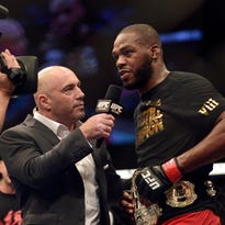 Apr 26, 2014; Baltimore, MD, USA;  Joe Rogan interviews Jon Jones after the UFC light heavy weight championship fight against Glover Teixeria at Baltimore Arena. Jones retained the light heavy height championship by defeating  Teixeria.  Mandatory Credit: Tommy Gilligan-USA TODAY Sports