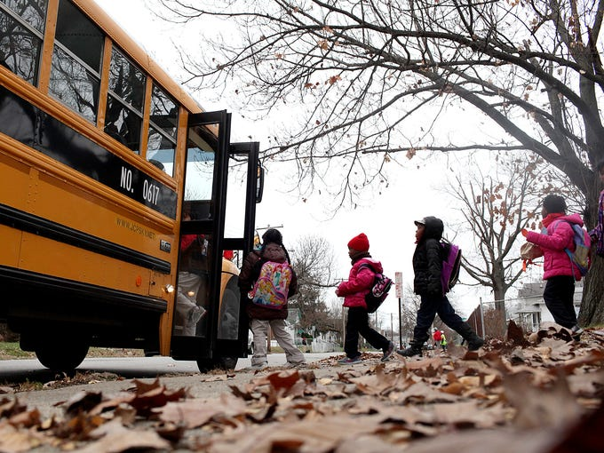 Students are seen leaving school at Young Elementary. November 25, 2013