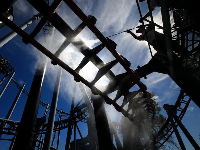 A crew pressure washes the paint off of the T2 coaster at Kentucky Kingdom.  The coaster will get a fresh coat of paint and be renamed T3 for next season. September 24, 2014
