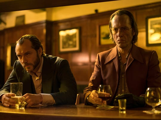 """Jude Law (left) and Richard E. Grant in a scene from """"Dom Hemingway."""""""