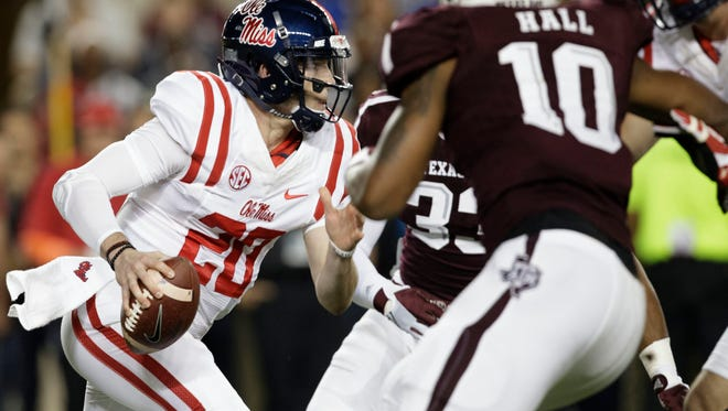 Mississippi quarterback Shea Patterson (20) runs through the line for yards against Texas A&M during the first quarter of an NCAA college football game Saturday, Nov. 12, 2016, in College Station, Texas. (AP Photo/Sam Craft)