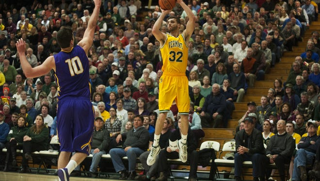Catamounts forward Ethan O'Day (32) takes a shot during the men's basketball game between the Albany Great Danes and the Vermont Catamounts at Patrick Gym on Wednesday night January 28.