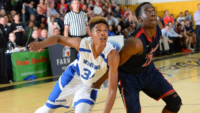 Shareef O' Neal, left, plays basketball March 7, 2015.
