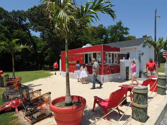 Several picnic tables make it easy to enjoy the Jimmy Buffett ambience at Fishkiller's Lobster Shack near Dagsboro. The seventh season for the food truck begins May 22.
