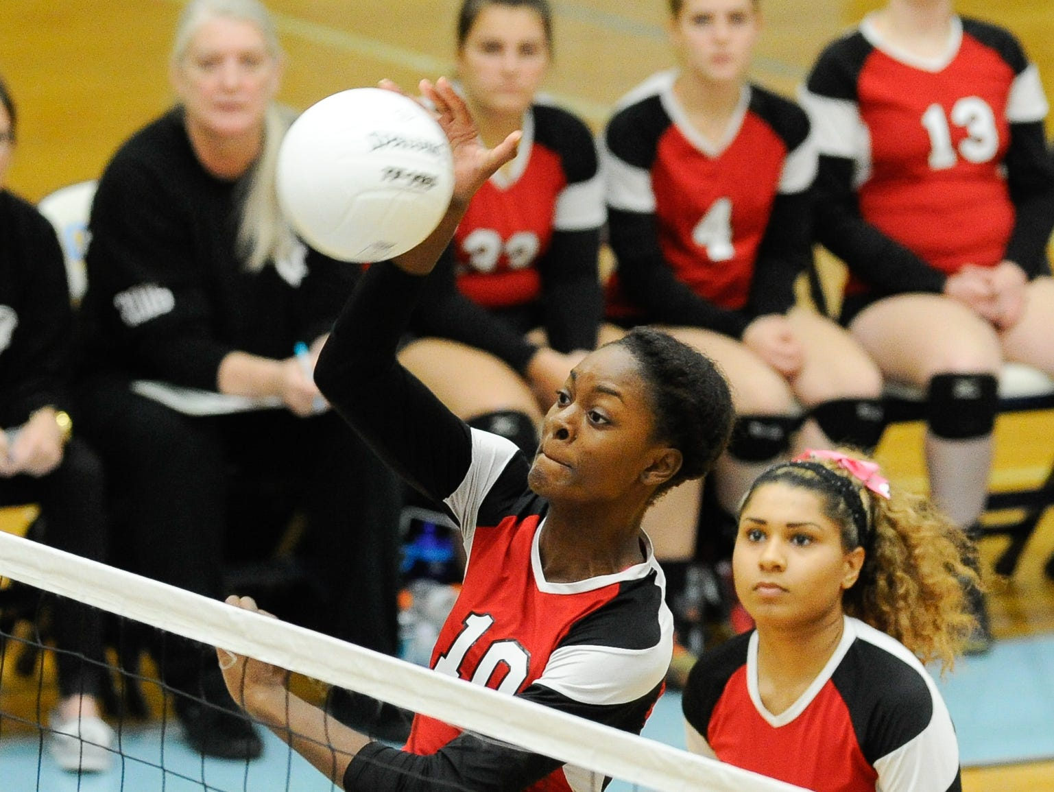 Conrad's #10 Amiya Rattley with a spike in the first game against Cape Thursday night at Cape Henlopen High School.
