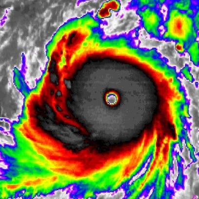 A color-enhanced satellite image shows Super Typhoon Soudelor spinning in the Pacific on Monday.