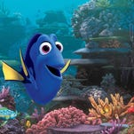 """FILE - This undated file image released by Disney shows the character Dory, voiced by Ellen DeGeneres, in a scene from """"Finding Dory."""" In a statement Tuesday, July 19, 2016, researchers at the University of Florida Tropical Aquaculture Laboratory said they had successfully bred Pacific blue tangs in captivity for the first time. The blue species is the model for the forgetful fish featured in the films """"Finding Nemo"""" and """"Finding Dory."""""""