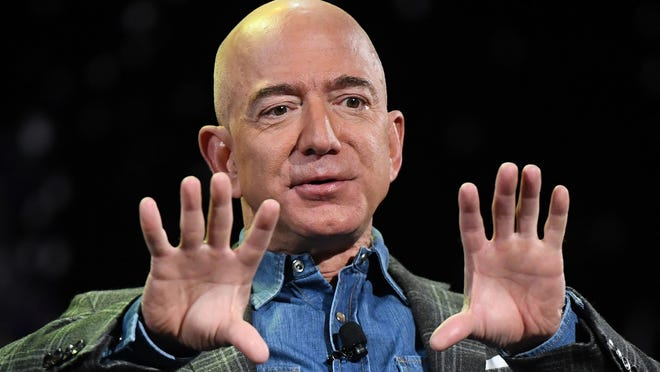 Amazon founder and CEO Jeff Bezos, shown here during a speech at a Las Vegas conference in June 2019, said the tech giant is donating $690,000 to Australia wildfire recovery efforts, but many critics are saying it's not enough.