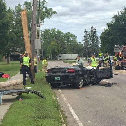 The scene of a car crash into a telephone pole Thursday afternoon on Vermont 15 near St. Michael's College in Colchester.