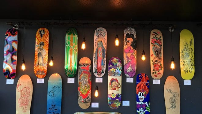 CONTRIBUTED PHOTO/CREATIVE MINDS Skateboard decks decorated by local artists.