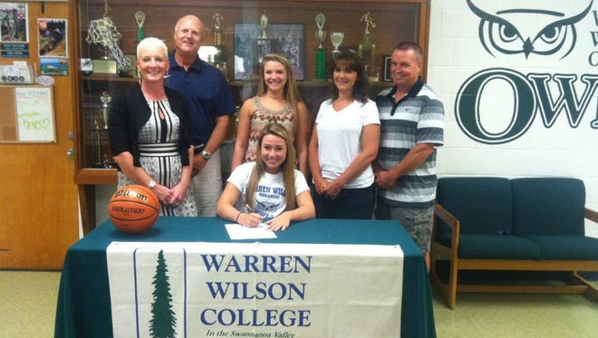 Roberson graduate Keila McCurry has signed to play college basketball for Warren Wilson.