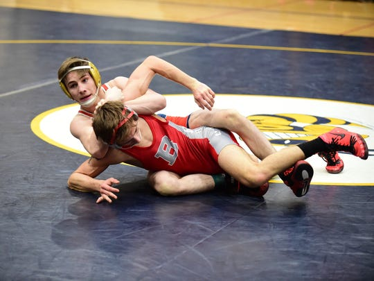 John Glenn Shawn Brown (top) looks to take control of the 140-pound bout against Bedford's Conner Frantz.