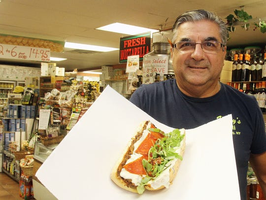 "Vinny Lamorte, owner of Vinny's Deli, with his ""Guilty"