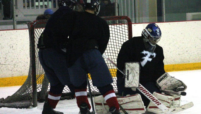 Livonia Franklin goal-tender Matt Monendo goes low to make a save during Tuesday's practice.