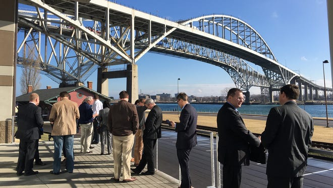 Attendees of the Michigan Local Government Management Association's winter institute stand on the porch of the Blue Water Convention Center earlier this year.