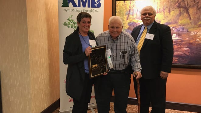 Northville Township representatives Marjorie Banner and Marv Gans accept the Keep Michigan Beautiful Award.