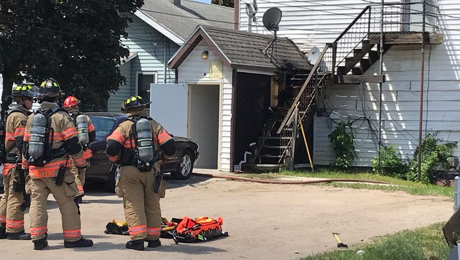 Fire crews respond to a structure fire at North Dakota Avenue and East Brookings Street Tuesday, May 30, 2017. Nobody was injured and the fire was knocked out in about 10 minutes.