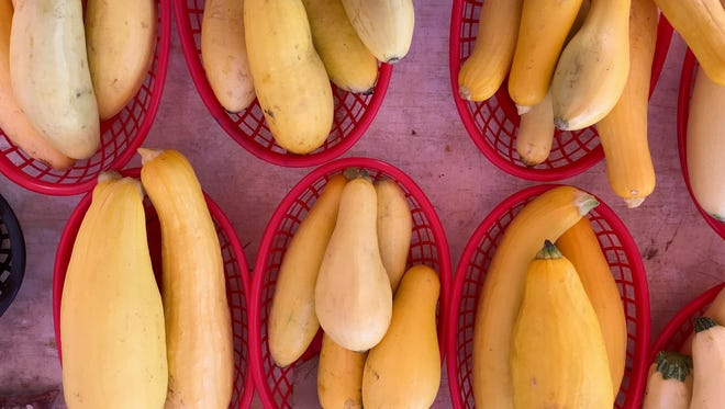Baskets of yellow squash on a table at the Abilene Farmers Market on Saturday.