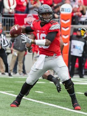 Ohio State quarterback J.T. Barrett looks to throw a pass against Michigan.
